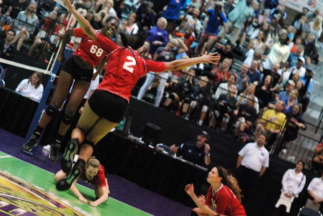 Nayo Warnell (68) finds air while Kylie Jedlicka dives for the floor after the tandem's combo block clinched 17 Open for AVA of Texas, the first Houston team to win an Open national title