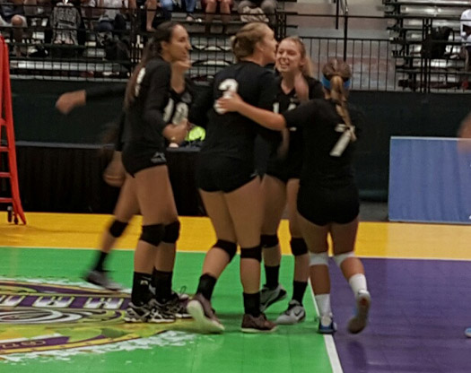 Laguna Beach players celebrate winnning a point and eventually earned the bronze medal.